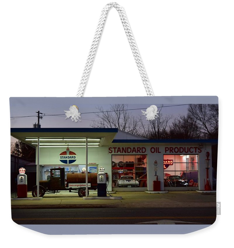 Standard Oil Museum Weekender Tote Bag featuring the photograph Standard Oil Museum After Dark 17 by Timothy Smith