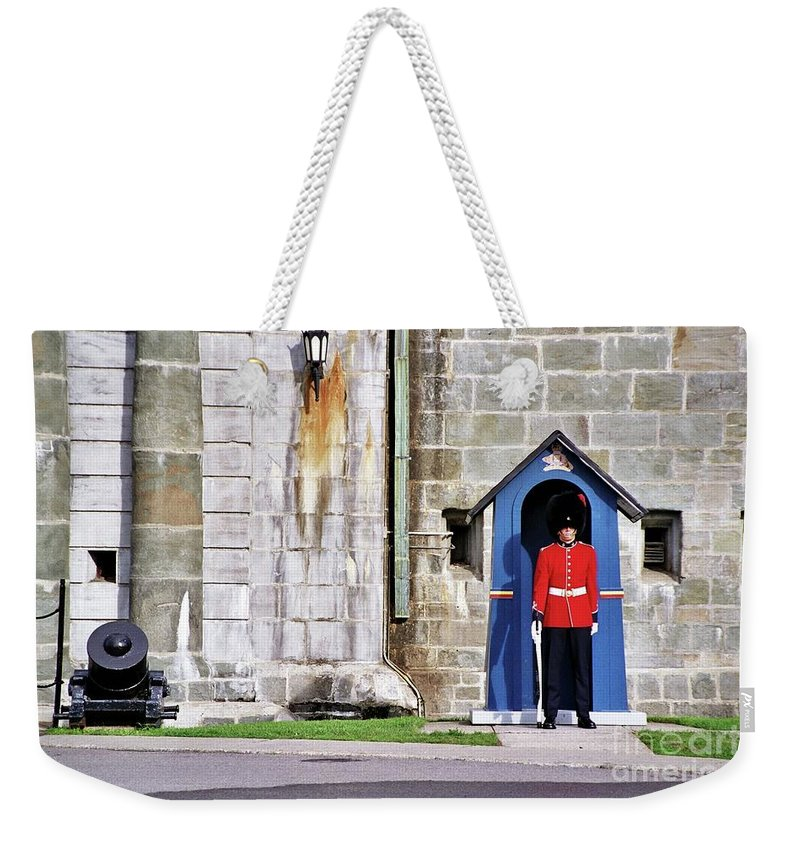 Standing Guard Weekender Tote Bag featuring the photograph Standing Guard by Allen Beatty