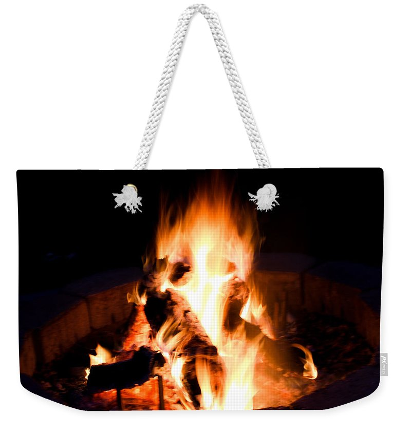 Fire Weekender Tote Bag featuring the digital art Staring Into The Fire by Mia DeBolt