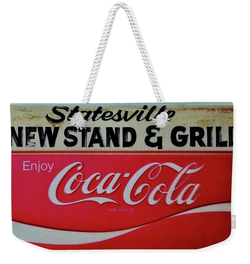 Newsstand Weekender Tote Bag featuring the photograph Statesville Newsstand by Cynthia Guinn