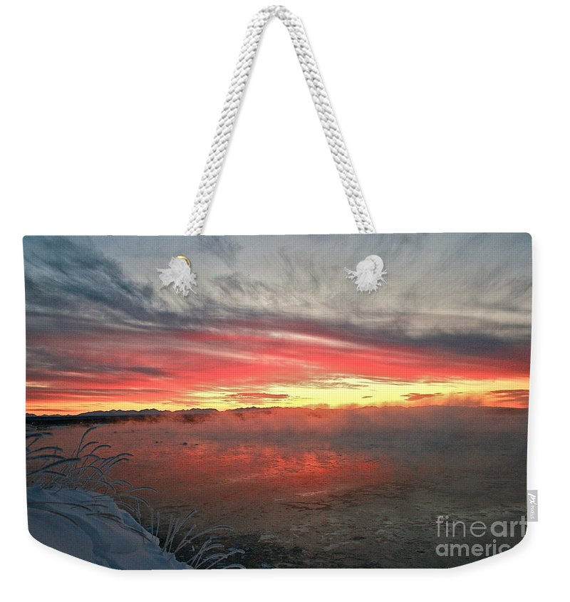 Winter Weekender Tote Bag featuring the photograph Steamy Winter Sunset by Rick Monyahan