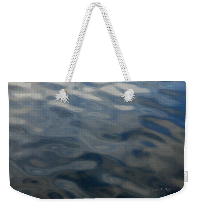 Water Weekender Tote Bag featuring the photograph Steel Blue by Donna Blackhall