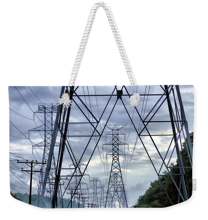 2d Weekender Tote Bag featuring the photograph Steel Soldiers Marching To The Sea by Brian Wallace