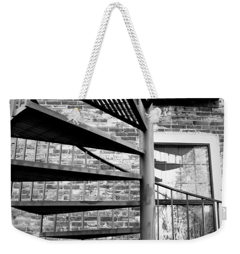 Brick Weekender Tote Bag featuring the photograph Steel Spiral by Greg Fortier