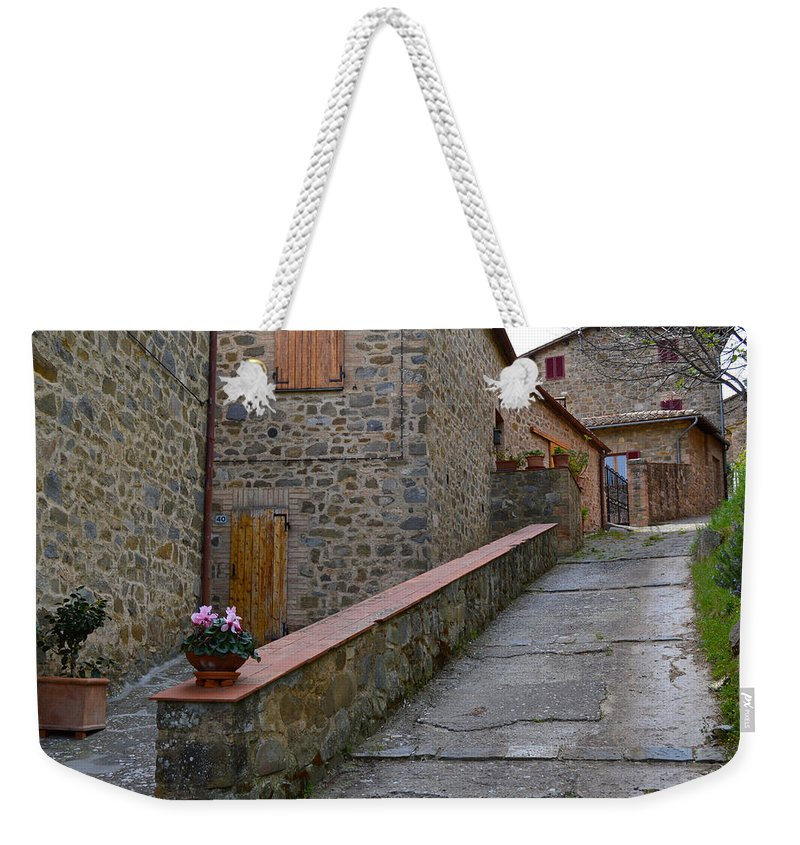 Flower Weekender Tote Bag featuring the photograph Steep Street In Montalcino Italy by Chris Alberding