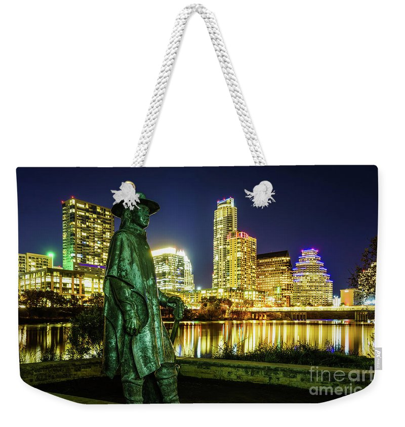 1st Weekender Tote Bag featuring the photograph Stevie Ray Vaughan Statue With Austin Tx Skyline by Paul Velgos