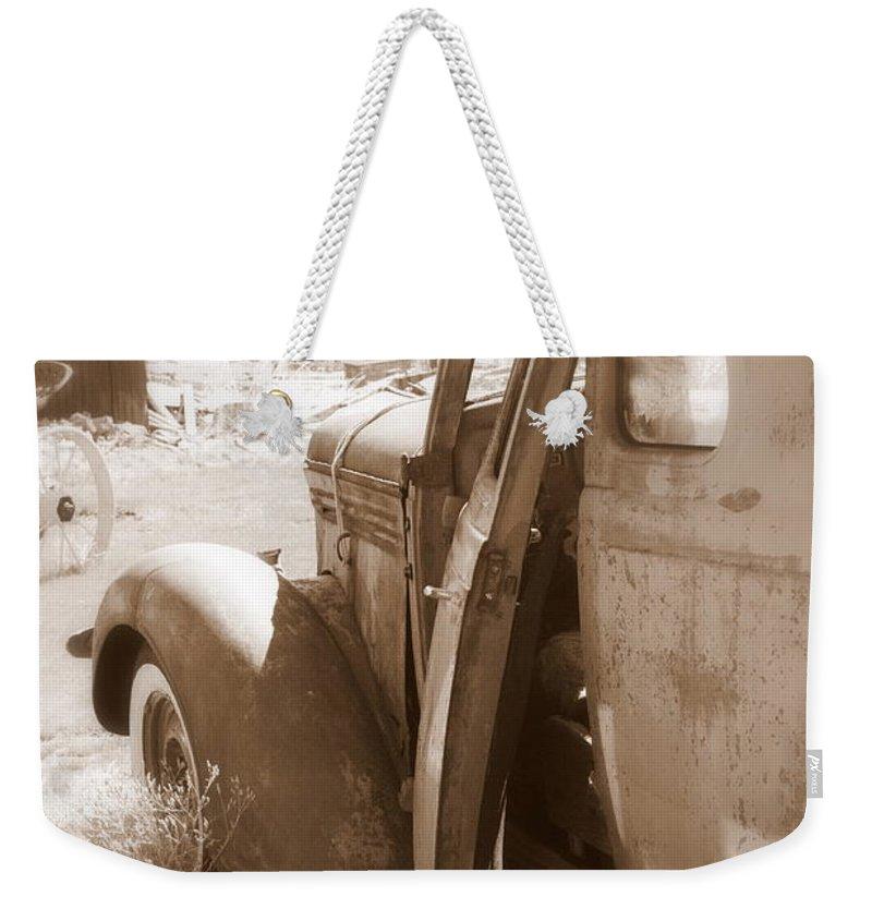 Disrepair Weekender Tote Bag featuring the photograph Still Waiting On Repairs by Carol Groenen