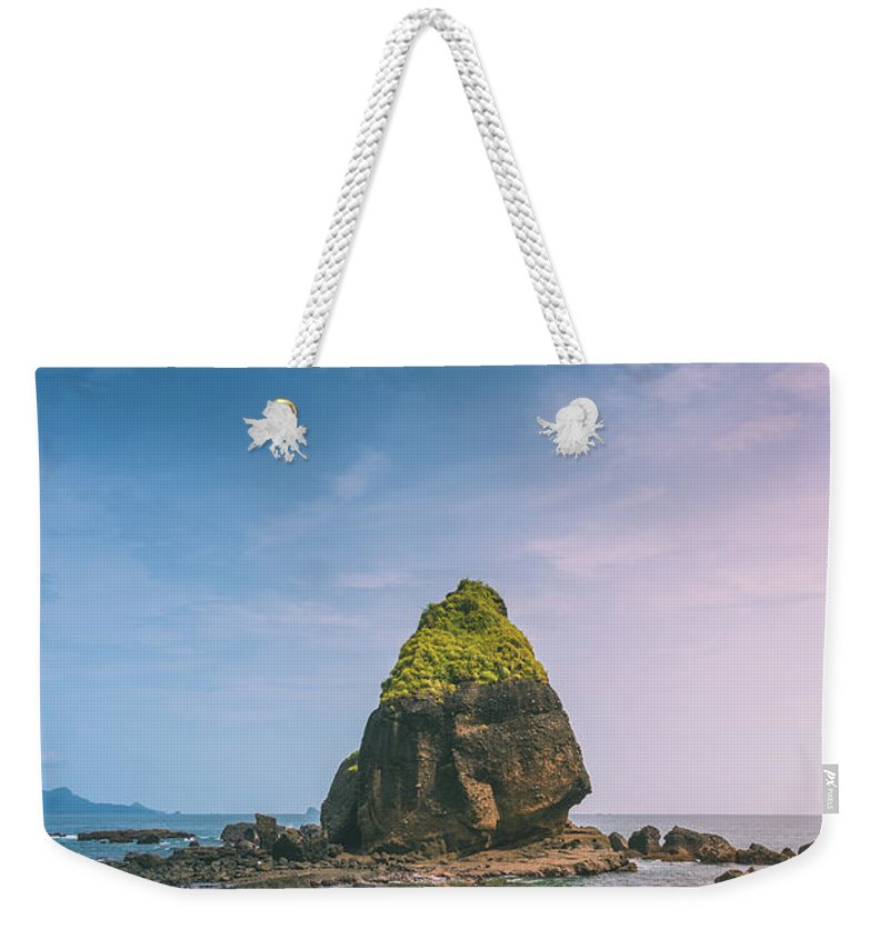 Stone Weekender Tote Bag featuring the photograph Stone Island by Derly Valent
