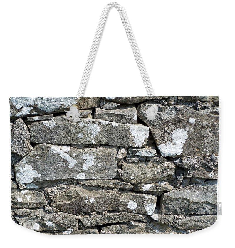Irish Weekender Tote Bag featuring the photograph Stone Wall Detail Doolin Ireland by Teresa Mucha