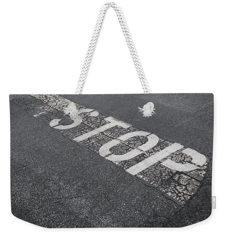Black And White Weekender Tote Bag featuring the photograph Stop Sign by Rob Hans