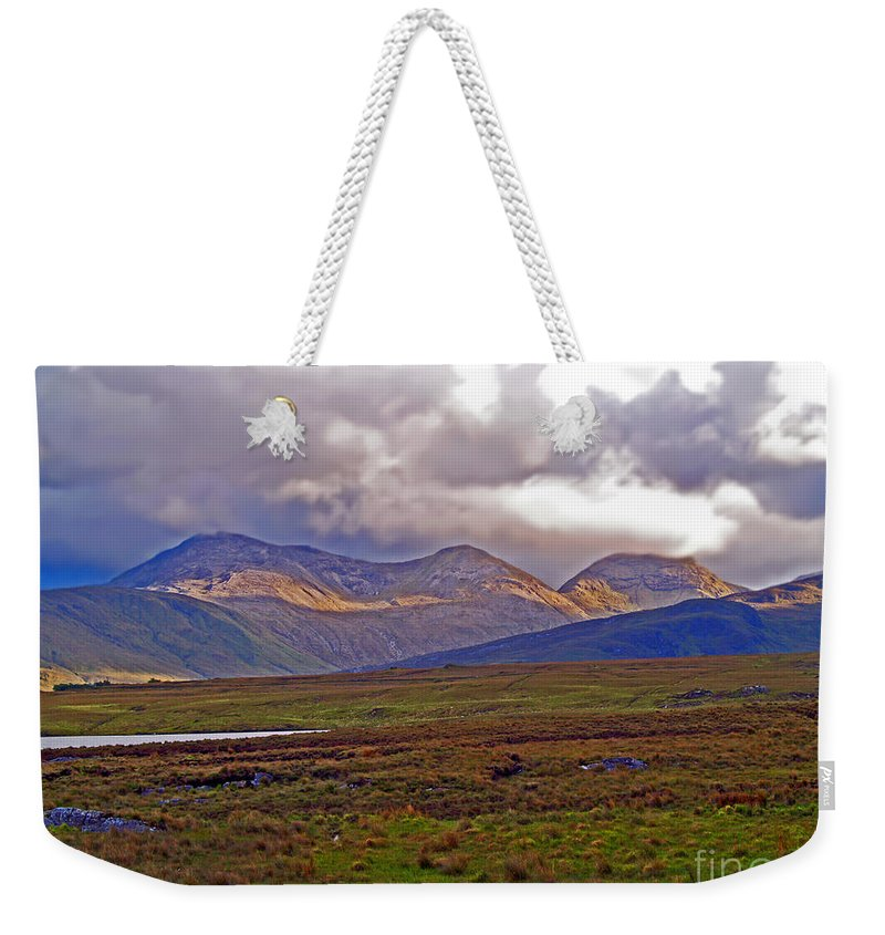 Fine Art Photography Weekender Tote Bag featuring the photograph Storm Clouds Ahead In Connemara by Patricia Griffin Brett