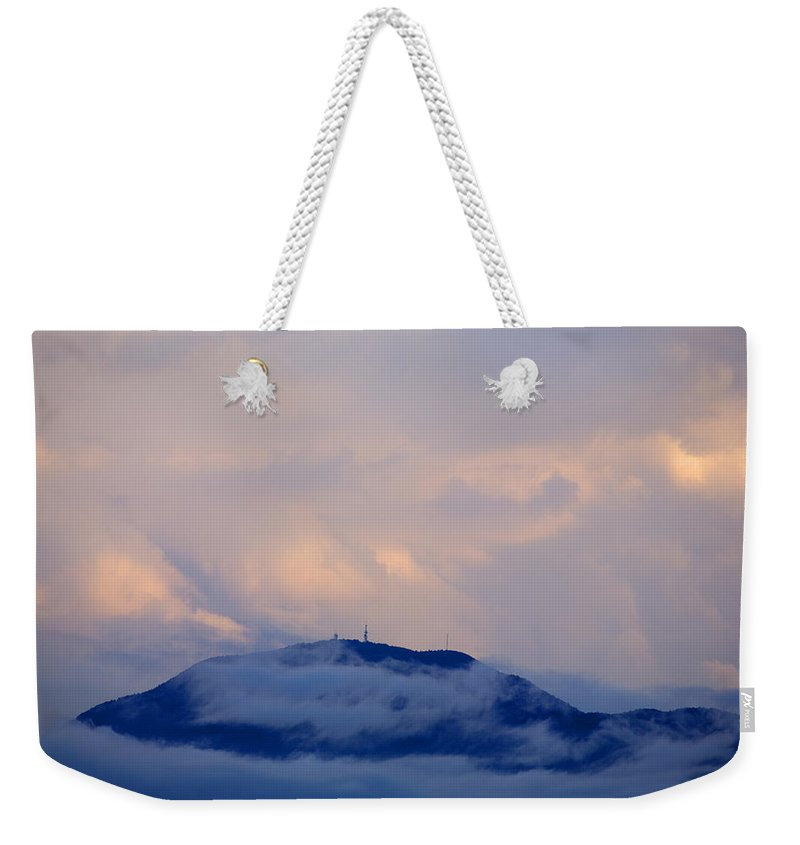 Storm Weekender Tote Bag featuring the photograph Storm Clouds Gather Over Mountains by Ian Middleton