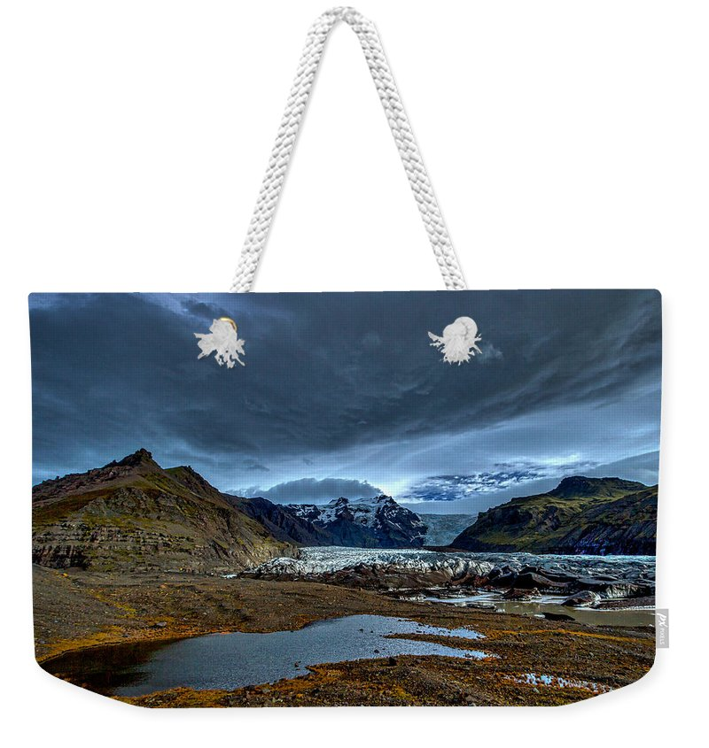 Glacier Weekender Tote Bag featuring the photograph Storm Clouds Over A Glacier - Iceland by Stuart Litoff