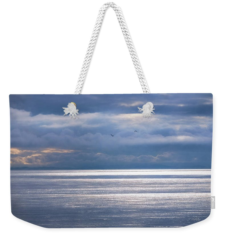 Storm Supremacy Weekender Tote Bag featuring the photograph Storm Supremacy by Jordan Blackstone