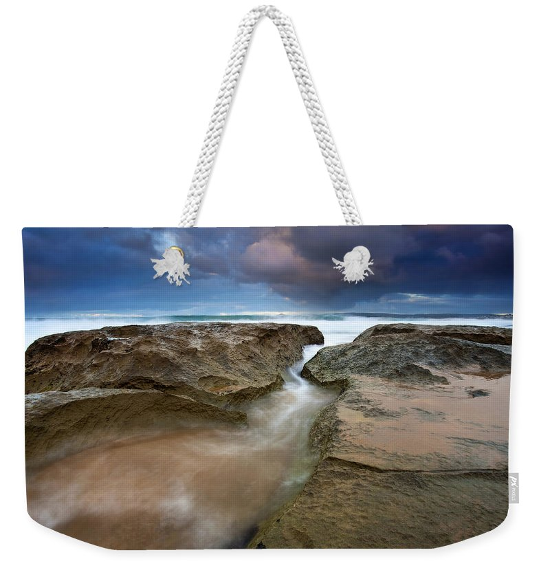 Storm Surge Weekender Tote Bag featuring the photograph Storm Surge by Mike Dawson