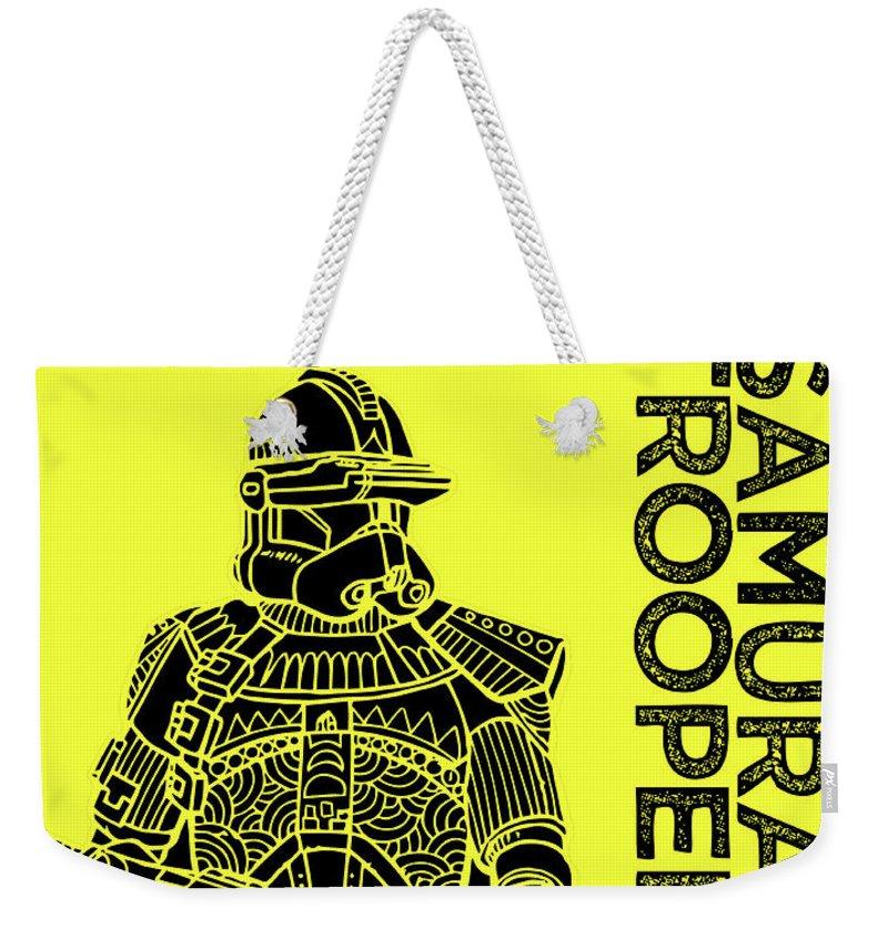 Stormtrooper Weekender Tote Bag featuring the mixed media Stormtrooper - Yellow - Star Wars Art by Studio Grafiikka
