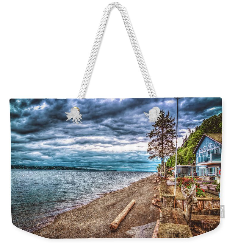 Beach Weekender Tote Bag featuring the photograph Stormy Beach by Spencer McDonald