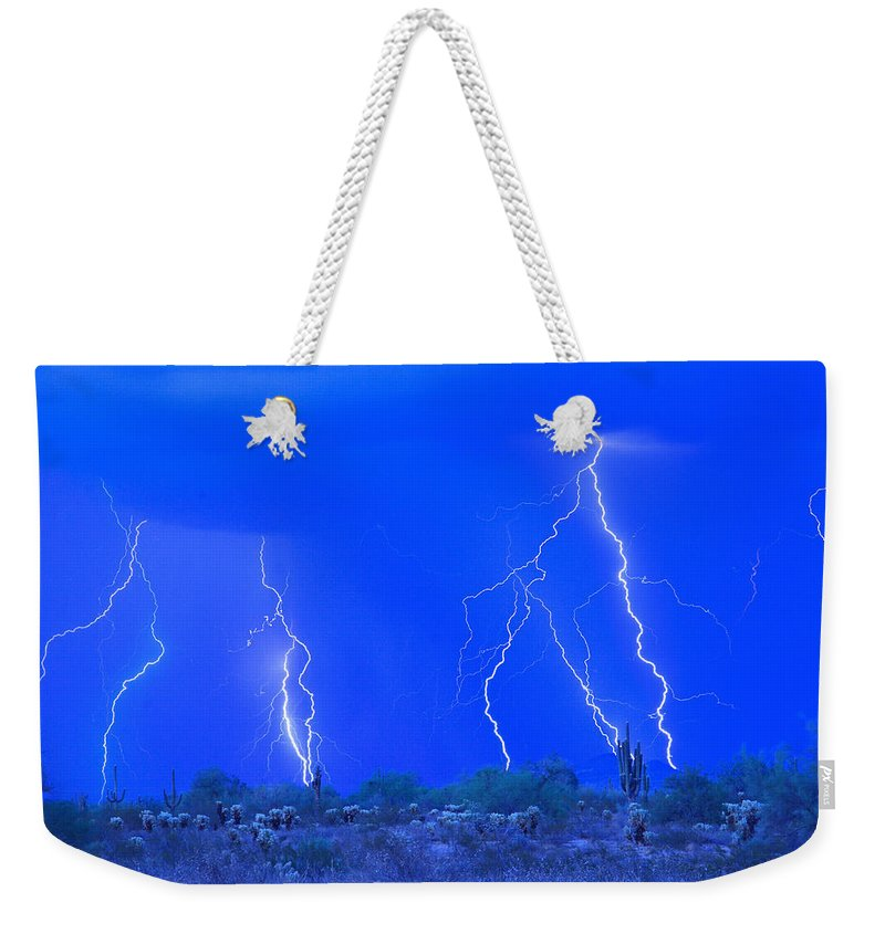 Lightning Weekender Tote Bag featuring the photograph Stormy Desert by James BO Insogna