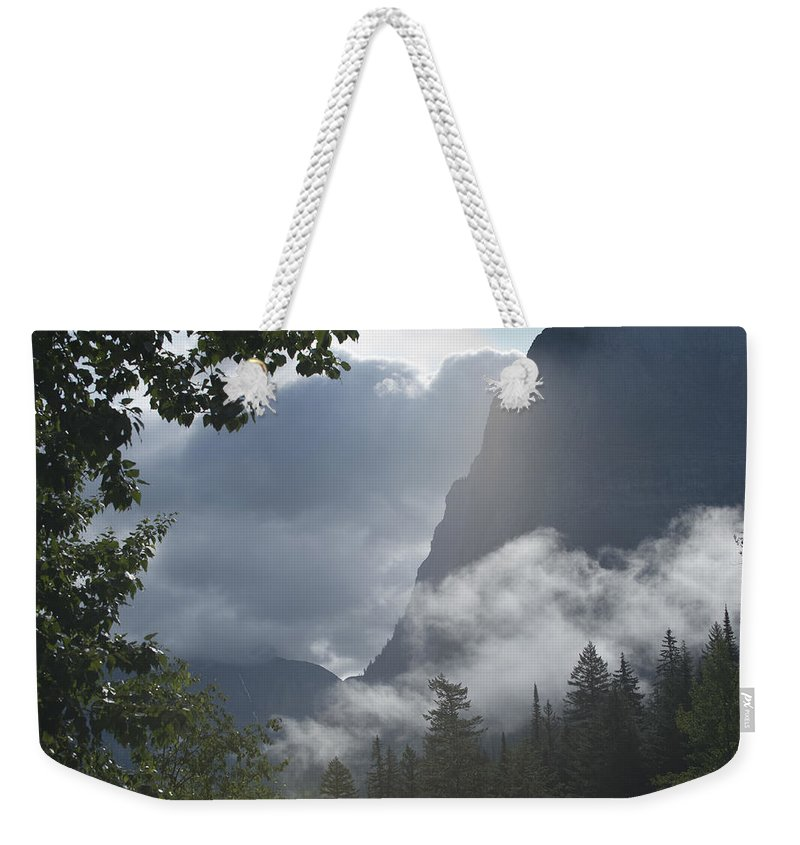 Glacier National Park Weekender Tote Bag featuring the photograph Stormy Morning In Glacier by Sandra Bronstein
