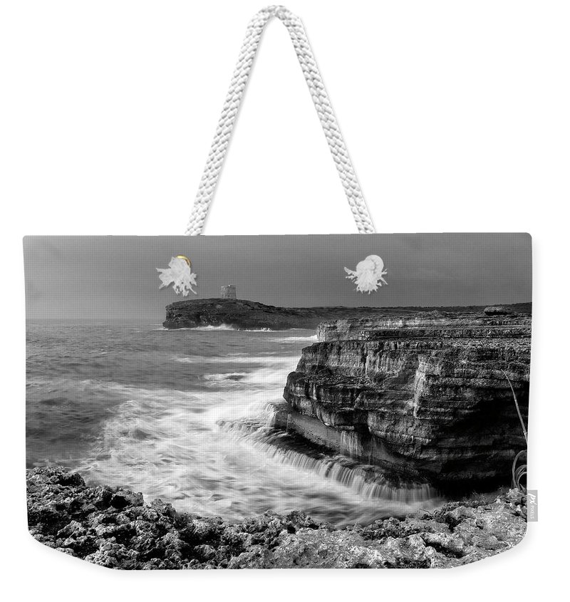 Storm Weekender Tote Bag featuring the photograph stormy sea - Slow waves in a rocky coast black and white photo by pedro cardona by Pedro Cardona Llambias