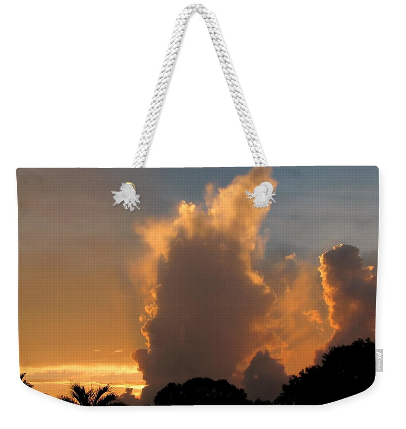 Nature Weekender Tote Bag featuring the photograph Stormy Sunset by Peg Urban