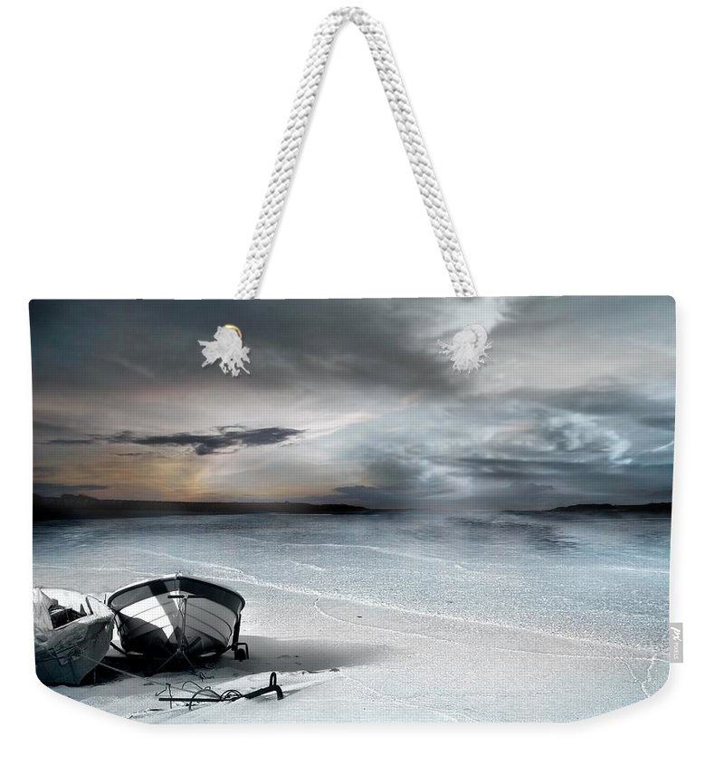 Water Weekender Tote Bag featuring the photograph Stranded by Jacky Gerritsen