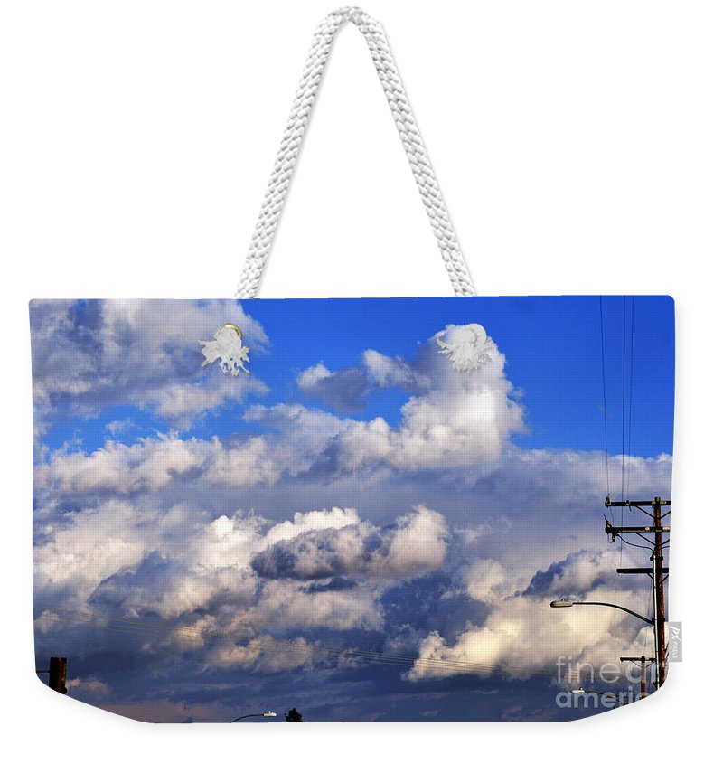 Clay Weekender Tote Bag featuring the photograph Strange Clouds by Clayton Bruster