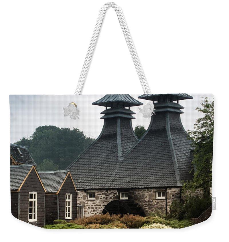 Scotland Weekender Tote Bag featuring the photograph Strathisla Whisky Distillery Scotland by Jan Bickerton
