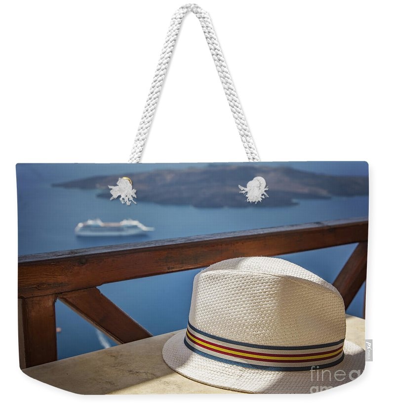 Santorini Weekender Tote Bag featuring the photograph Straw Hat by Sophie McAulay