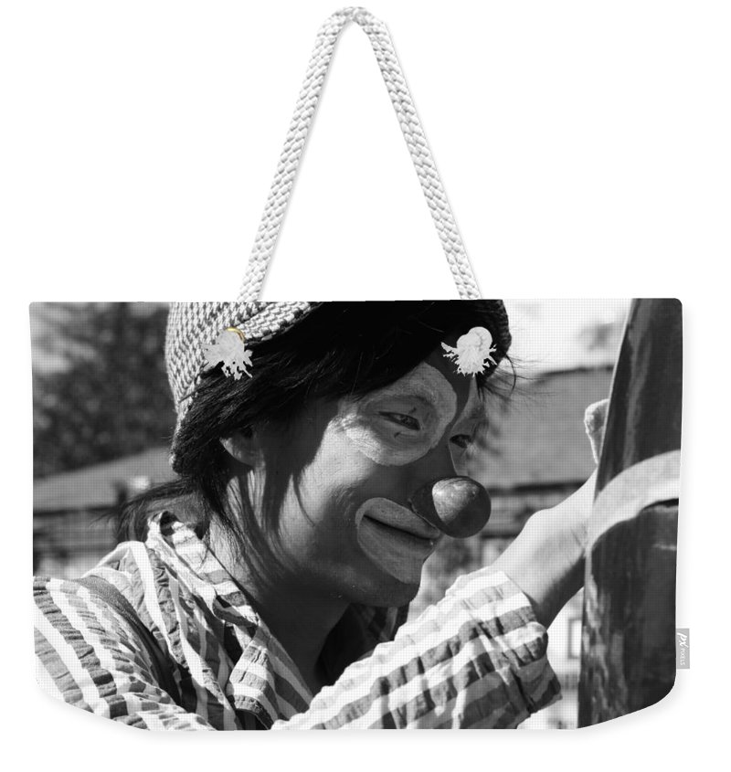 Street Photography Weekender Tote Bag featuring the photograph Street Clown by The Artist Project