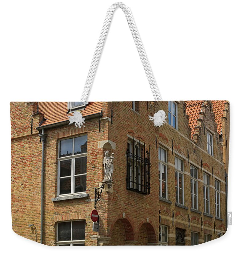 Street Weekender Tote Bag featuring the photograph Street Corner In Bruges Belgium by Louise Heusinkveld