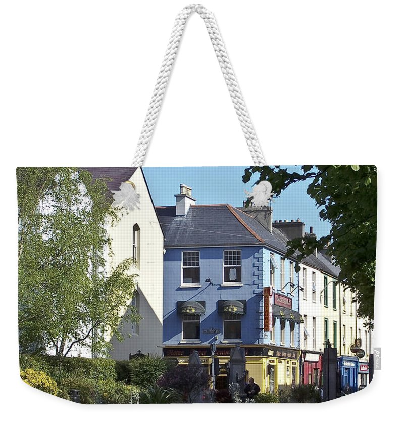 Irish Weekender Tote Bag featuring the photograph Street Corner In Tralee Ireland by Teresa Mucha