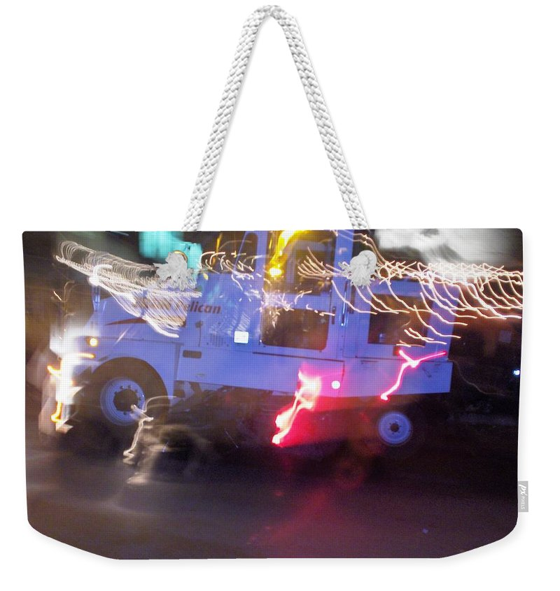 Photograph Weekender Tote Bag featuring the photograph Street Sweeper by Thomas Valentine