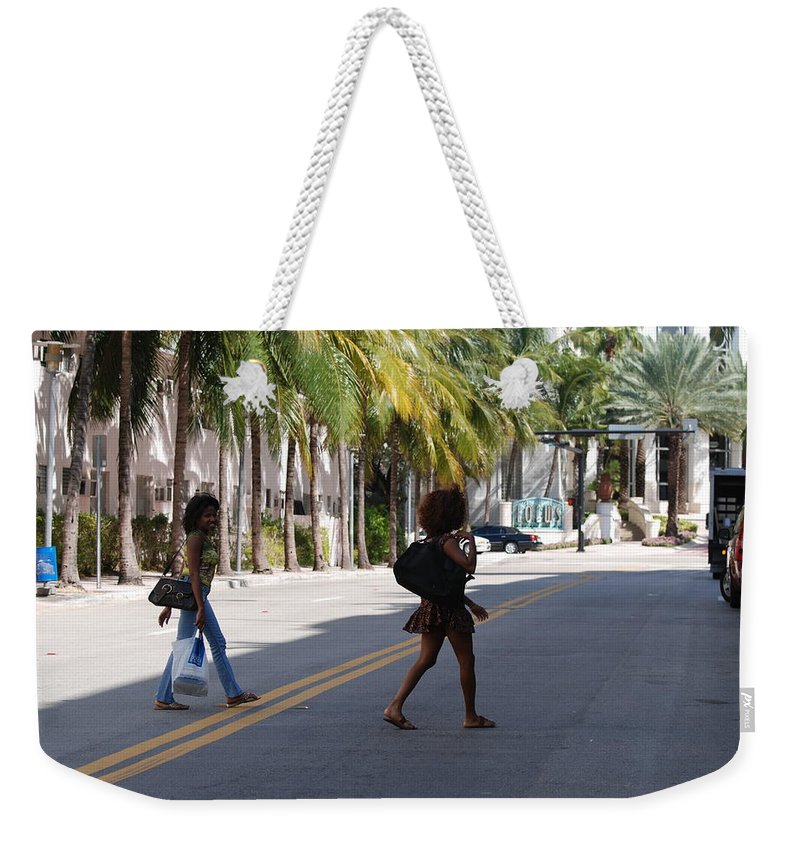 Girls Weekender Tote Bag featuring the photograph Street Walkers by Rob Hans