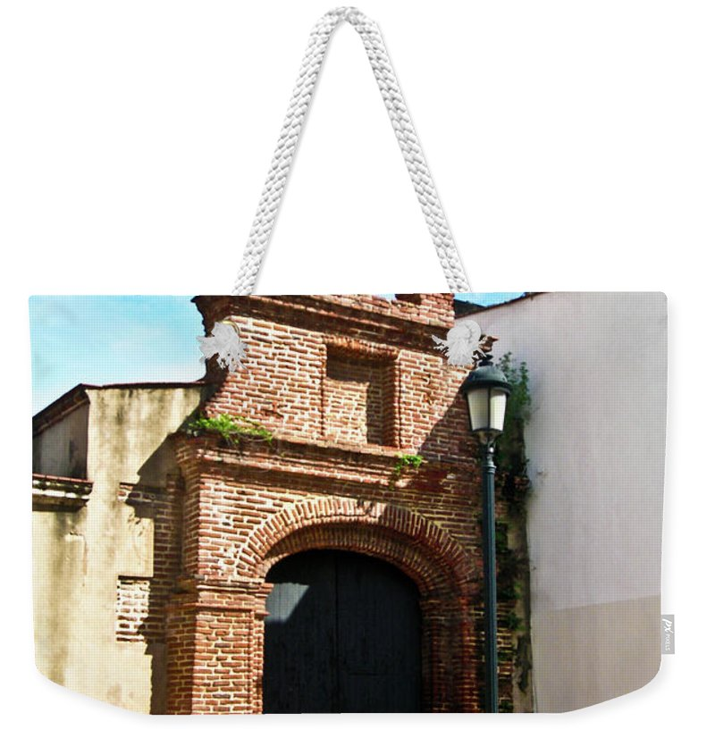 Streetlight Weekender Tote Bag featuring the photograph Streetlight Bells And Cross by Douglas Barnett