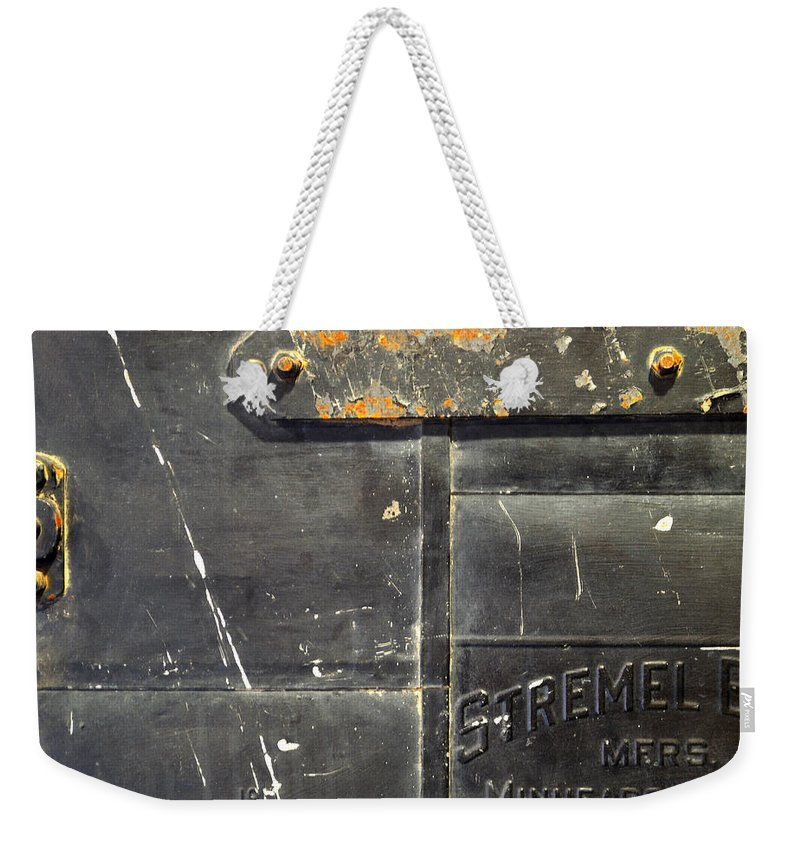 Firedoor Weekender Tote Bag featuring the photograph Stremel Bros. Firedoor by Tim Nyberg