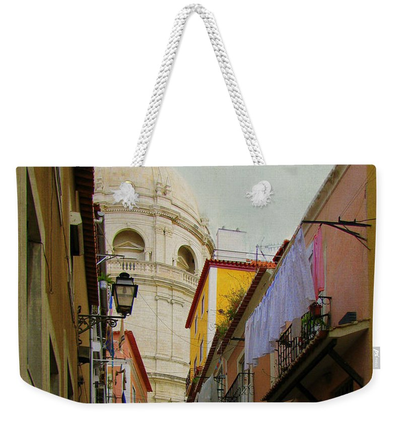Lisbon Weekender Tote Bag featuring the photograph Street Scene In Alfama District Of Lisbon by Carla Parris