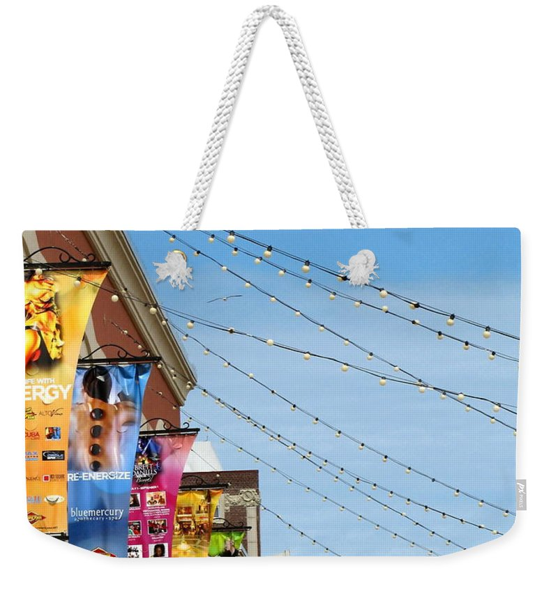 Lights Weekender Tote Bag featuring the photograph String Of Lights by Colleen Kammerer