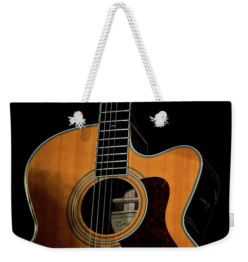 Guitar Weekender Tote Bag featuring the photograph Strings Of My Heart... by Oleksiy Maloshtan
