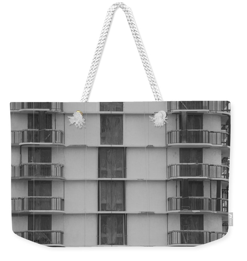 Black And White Weekender Tote Bag featuring the photograph Stripes by Rob Hans