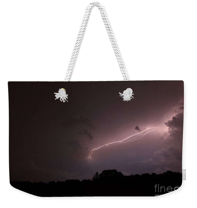 Lightning Weekender Tote Bag featuring the photograph Strong Arm by Amanda Barcon