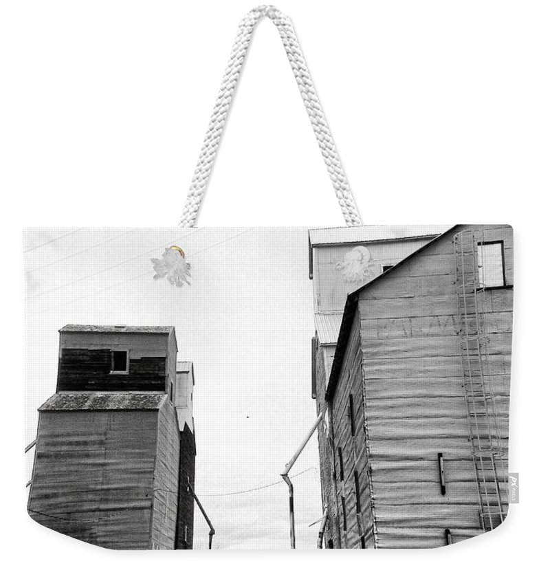 Montana Weekender Tote Bag featuring the photograph Stuck In The Middle by Susan Kinney