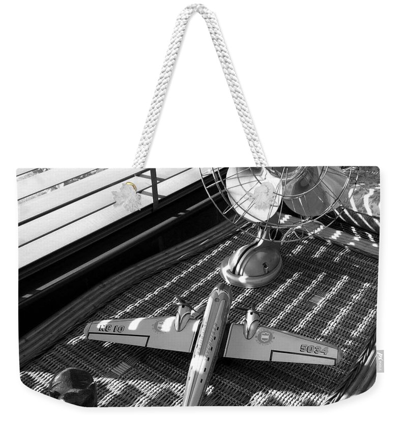 Still Life Weekender Tote Bag featuring the photograph Suburban Runway by Charles Stuart