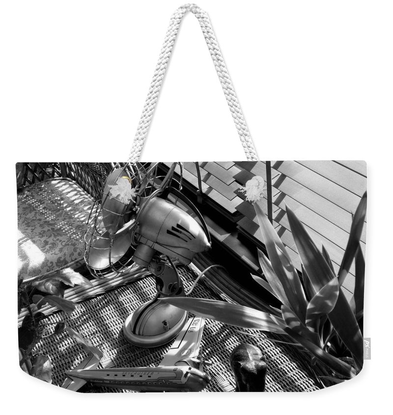 Still Life Weekender Tote Bag featuring the photograph Suburban Safari by Charles Stuart