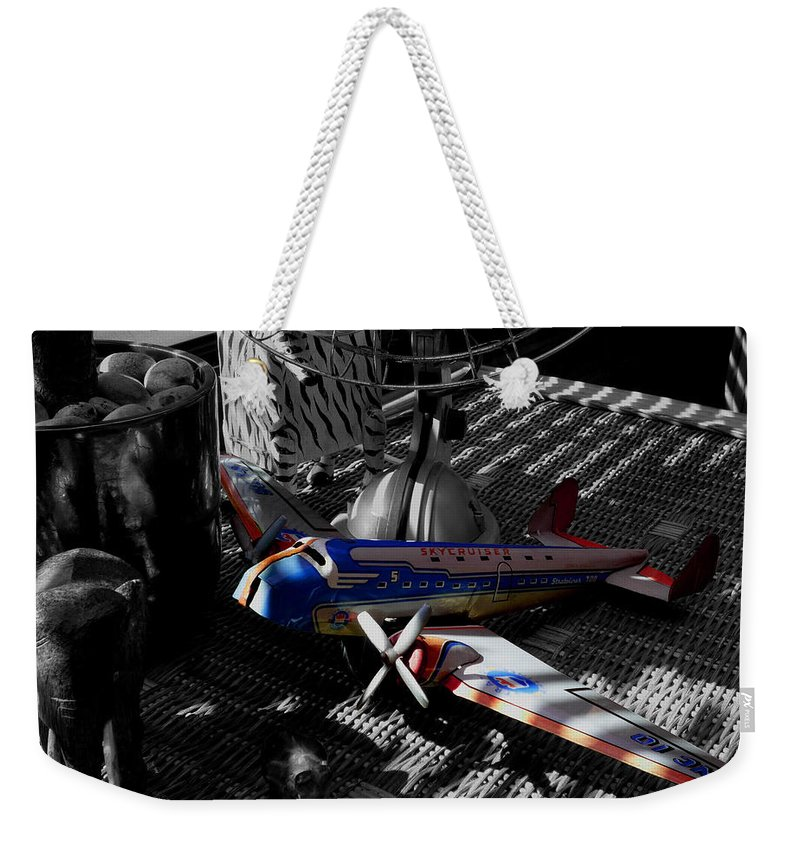 Still Life Weekender Tote Bag featuring the photograph Suburban Safari The Zebra Strikes Back by Charles Stuart