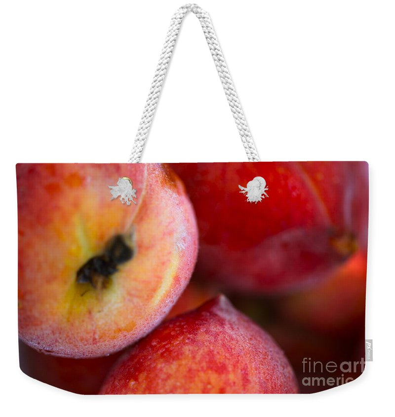 Peach Weekender Tote Bag featuring the photograph Summer Peaches by Nadine Rippelmeyer