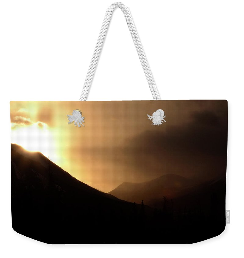 Sun Weekender Tote Bag featuring the digital art Sun Behind Clouds In Rocky Mountains Of Alberta Canada by Mark Duffy