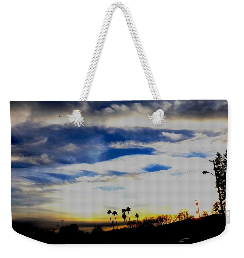 Sunset Sky Jet Southern California Weekender Tote Bag featuring the photograph Sun Bound by Steven Canizales