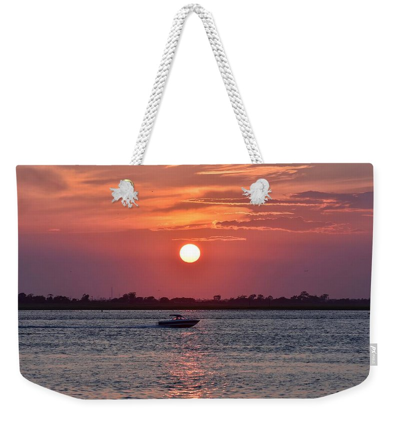 Sunset Weekender Tote Bag featuring the photograph Sun Chasing by Kyle Cermak