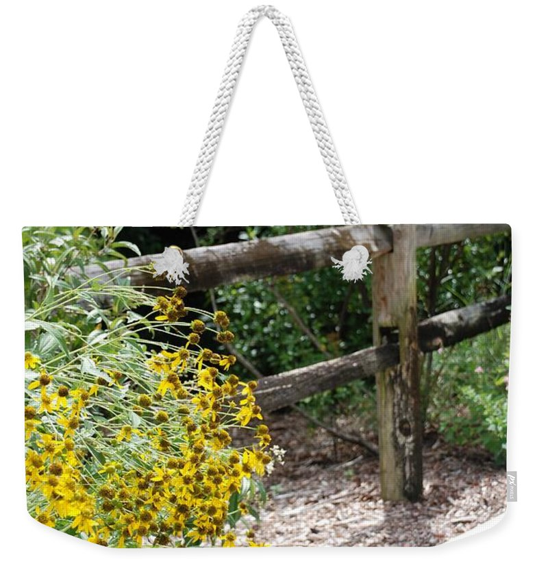 Macro Weekender Tote Bag featuring the photograph Sun Flower Fence by Rob Hans